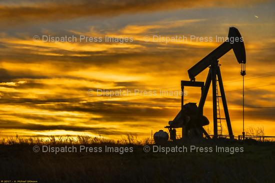 Oil Rig In The Sunset