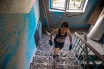 Boy Walking Through Rubble